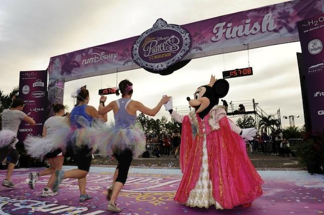 Minnie high-fives runners